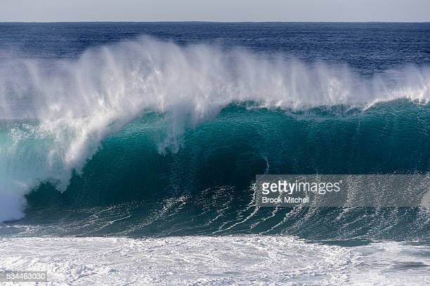 A huge wave breaks at Tamarama on May 25 2016 in Sydney Australia All Sydney beaches were closed to swimmers today as large waves pounded the coast