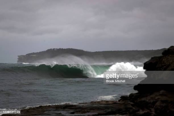 A huge wave breaks inside Botany Bay at La Perouse on May 23 2020 in Sydney Australia Winter weather including rain and strong winds is expected to...