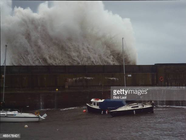 CONTENT] A huge wave breaks over Dunbar harbour Scotland during a North Sea Storm the photograph was taken from my house's front door
