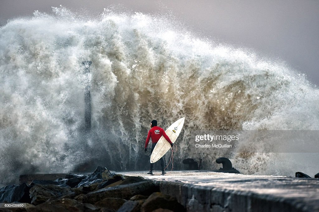 A Pro-surfer Waits For A Break In The Surge : News Photo