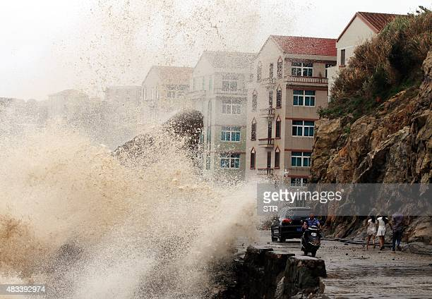 A huge wave surges onto a road in Wenling east China's Zhejiang province as typhoon Soudelor draws near the mainland of China on August 8 2015...