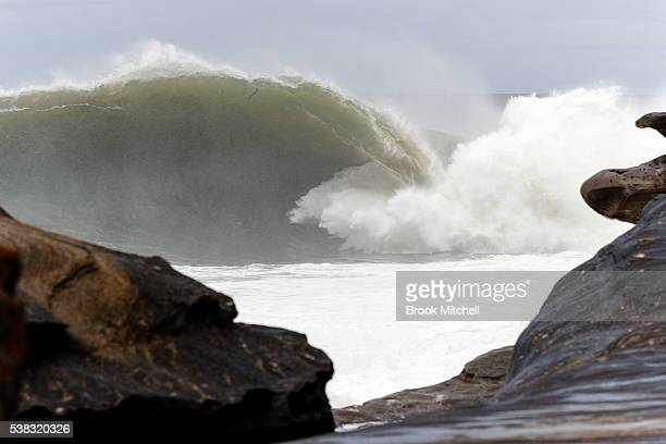 Huge waves break during Cape Fear on June 6 2016 in Sydney Australia The swell is one of the largest to hit the reef in the past decade