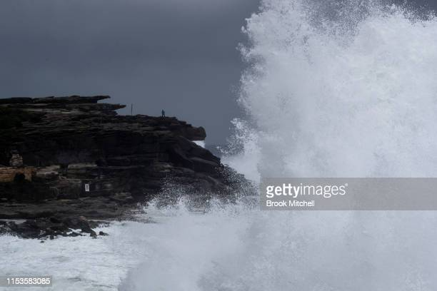 Huge waves crash into the cliffs at Clovelly in Sydney's East on June 04 2019 in Sydney Australia The Bureau of Meteorology issued a severe weather...