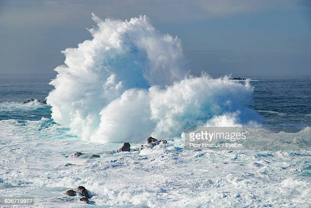 Huge Waves Crashing On Sea Against Sky