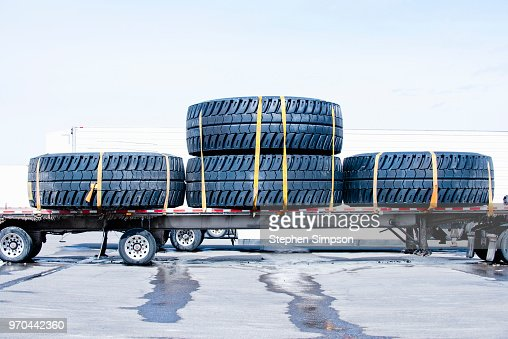 Huge wheels on flatbed truck