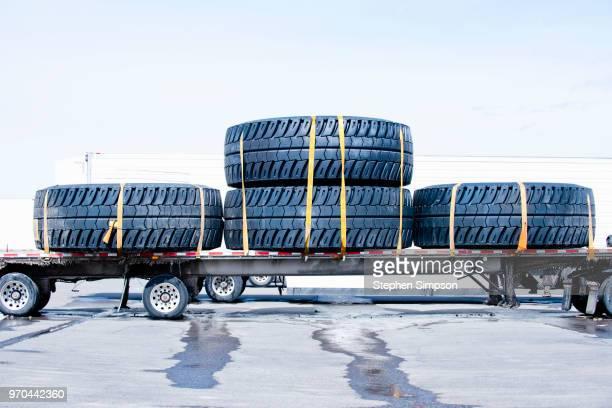Huge wheels on flatbed truck