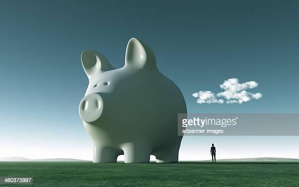 Huge white piggy bank on green gras