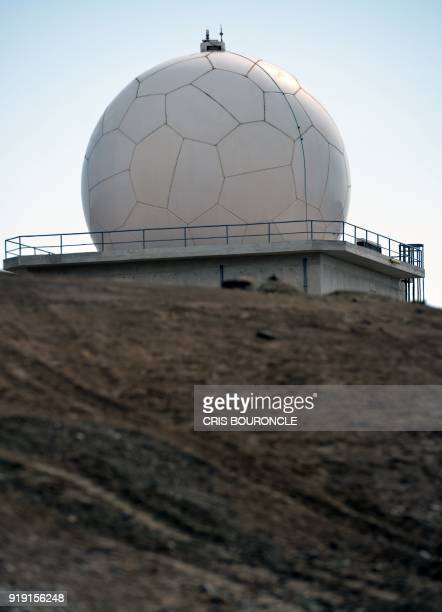 A huge white sphere similar to a giant soccer ball sits on a hill by the National Satellite Image Operation Centre in Pucusana Peru some 60...