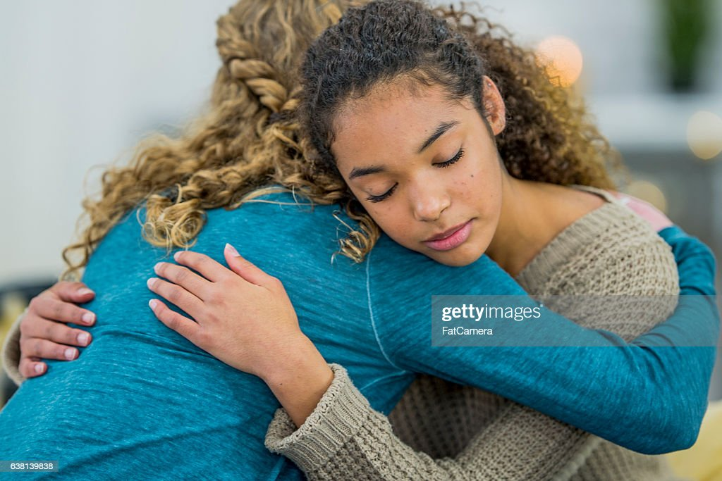 Hugging a Friend : Stock Photo