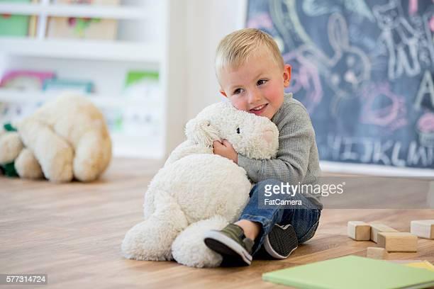 Hugging a Stuffed Animal