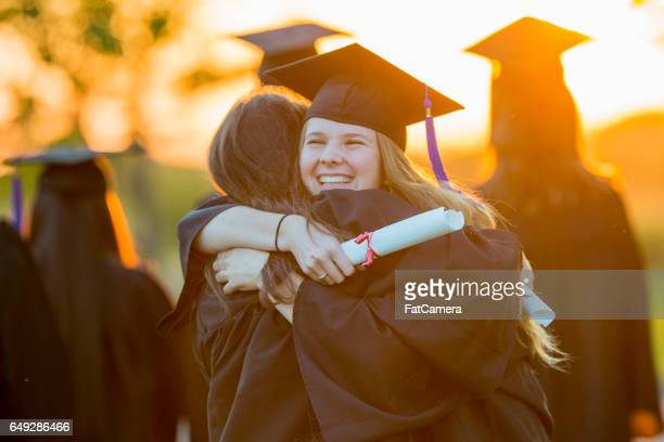hugging after graduation - tassel stock pictures, royalty-free photos & images