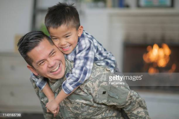 hugging dad - family politics stock pictures, royalty-free photos & images