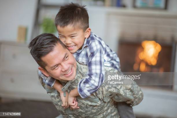hugging dad - filipino family reunion stock pictures, royalty-free photos & images