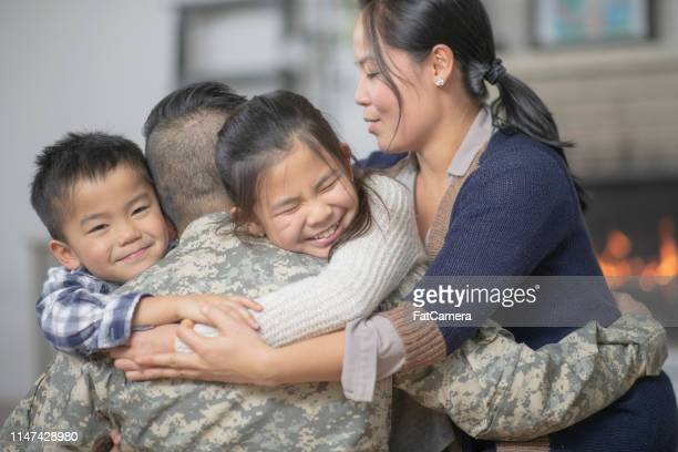 hugging family - family politics stock pictures, royalty-free photos & images