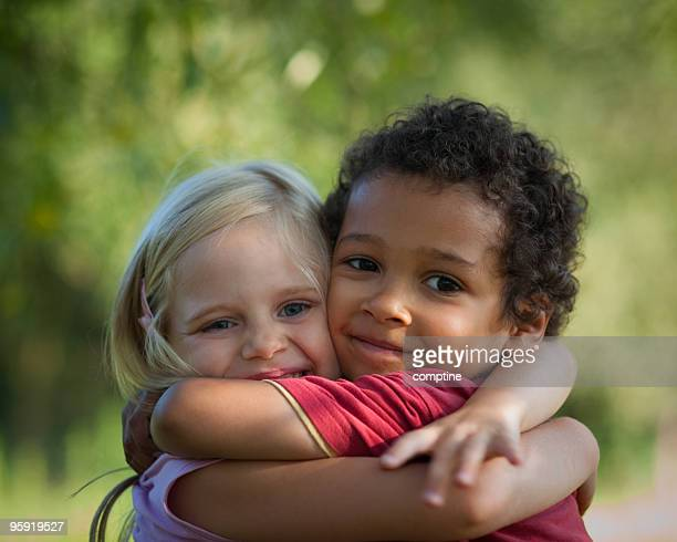 hugging for peace - love at first sight stock pictures, royalty-free photos & images