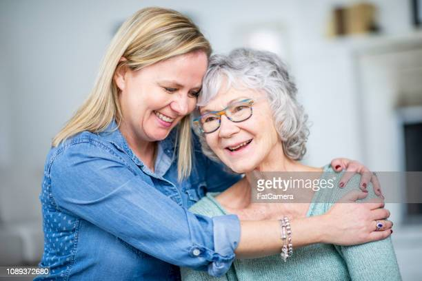 hugging mom - daughter stock pictures, royalty-free photos & images