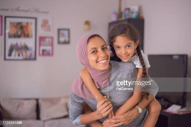 hugging mom - middle east stock pictures, royalty-free photos & images