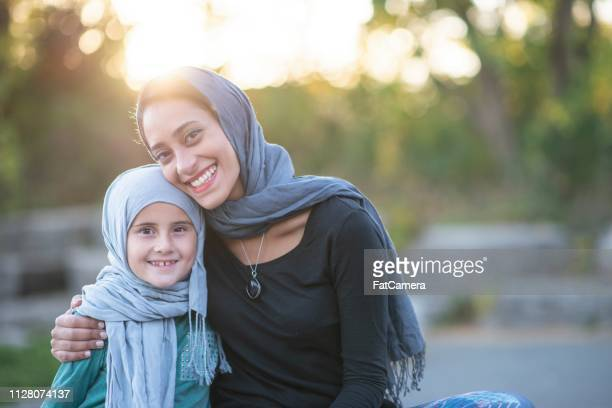 hugging mother and daughter - displaced people stock pictures, royalty-free photos & images