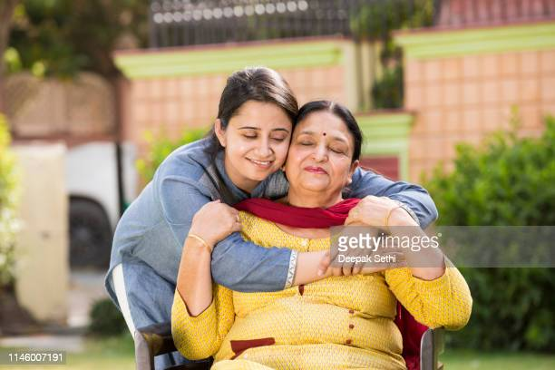 hugging mother in love - stock images - mother in law stock pictures, royalty-free photos & images