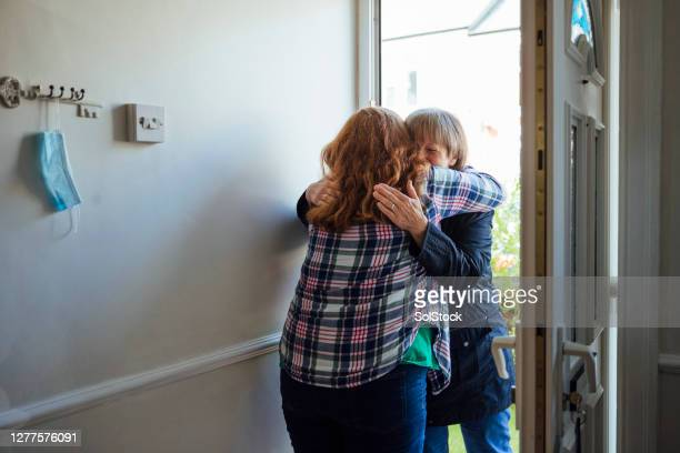 hugging my mother again - positive emotion stock pictures, royalty-free photos & images