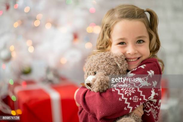 hugging teddy - stuffed toy stock pictures, royalty-free photos & images