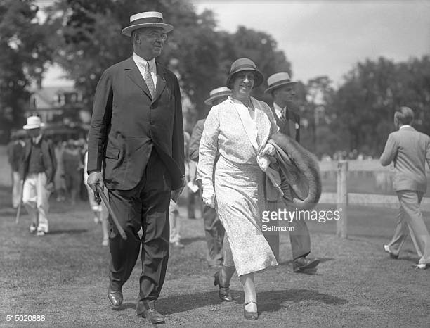 Hugh Bancroft publisher of several financial journals is seen here with Mrs Bancroft as they attended the 42nd annual race meeting of the Eastern...