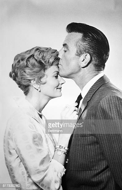 Hugh Beaumont and Barbara Billingsley kiss in a publicity still for the TV show Leave It To Beaver which which they play Ward and June Cleaver