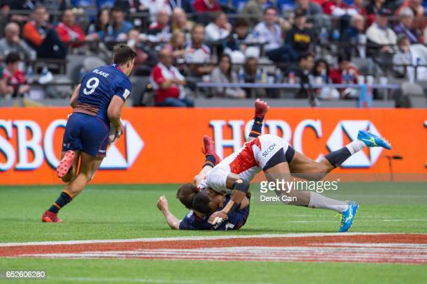 Hugh Blake of Scotland runs up field with the ball as James Fleming of Scotland is hit by Kameli Soejima of Japan during day 2 of the 2017 Canada...