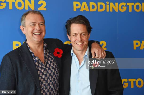 Hugh Bonneville and Hugh Grant attend a photocall for 'Paddington 2' at ShangriLa Hotel The Shard on November 3 2017 in London England