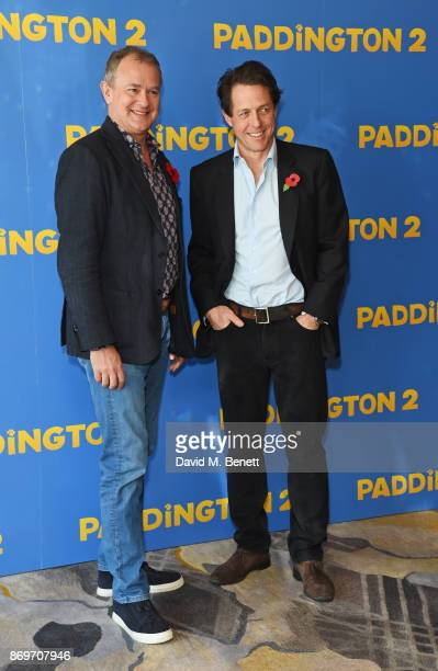 Hugh Bonneville and Hugh Grant attend a photocall for Paddington 2 at ShangriLa Hotel The Shard on November 3 2017 in London England