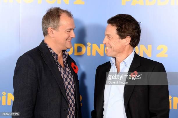 Hugh Bonneville and Hugh Grant attend the 'Paddington 2' photocall at ShangriLa Hotel on November 3 2017 in London England