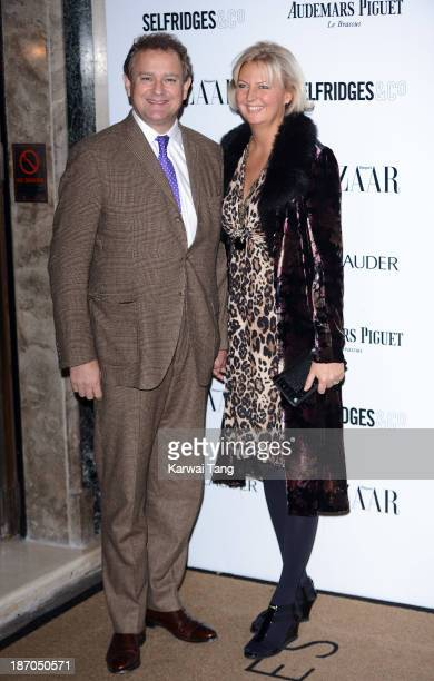 Hugh Bonneville and Lulu Williams attend the Harpers Bazaar Women of the Year Awards at Claridge's Hotel on November 5 2013 in London England