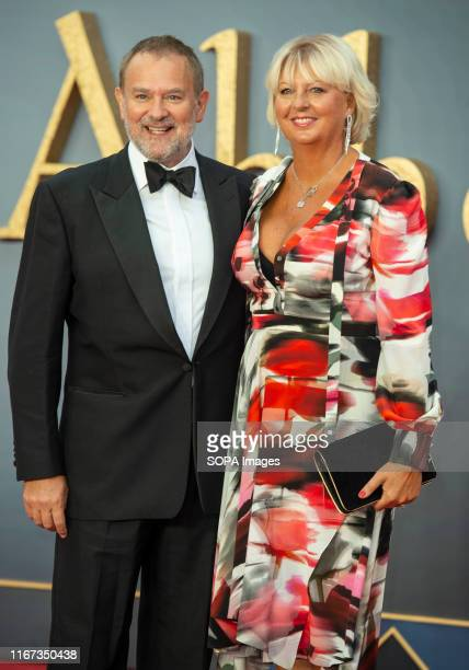 Hugh Bonneville and Lulu Williams attend the World Premiere Of Downton Abbey at Leicester Square in London.
