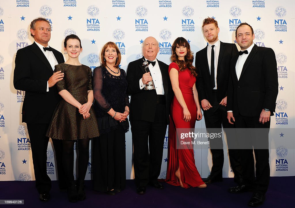 Hugh Bonneville, Sophie McShera, Phyllis Logan, creator Julian Fellowes, Lily James, winner of Drama award for 'Downton Abbey', poses in the Winners room at the National Television Awards at 02 Arena on January 23, 2013 in London, England.