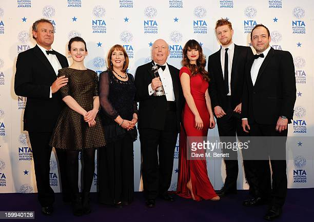 Hugh Bonneville Sophie McShera Phyllis Logan creator Julian Fellowes Lily James winner of Drama award for Downton Abbey poses in the Winners room at...