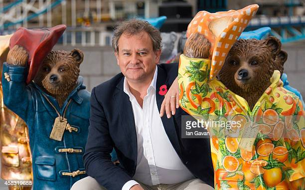 Hugh Bonneville stands alongside his 'Journey of Marmalade' Paddington Bear stature at the launch of The Paddington Trail at The Scoop More London on...
