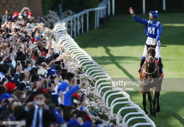 Hugh Bowman celebrates on returning to scale after winning on Winx in race 9 the Ladbrokes Cox Plate during Cox Plate Day at Moonee Valley Racecourse...