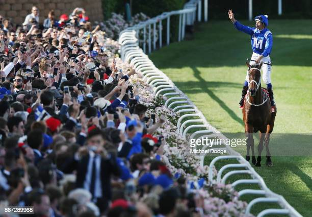Hugh Bowman celebrates on returning to scale after winning on Winx to win race 9 the Ladbrokes Cox Plate during Cox Plate Day at Moonee Valley...