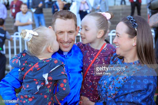 Hugh Bowman cuddles daughters Paige and Bambi with wife Christine after winning the Golden Rose on Bivouac during the Golden Rose Day Sydney Racing...