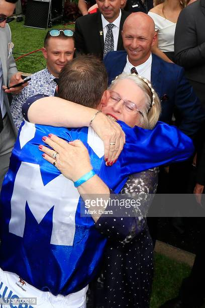 Hugh Bowman hugs his mother after winning race 5 The Ranvet Stakes on Winx during Golden Slipper Day at Rosehill Gardens on March 23 2019 in Sydney...