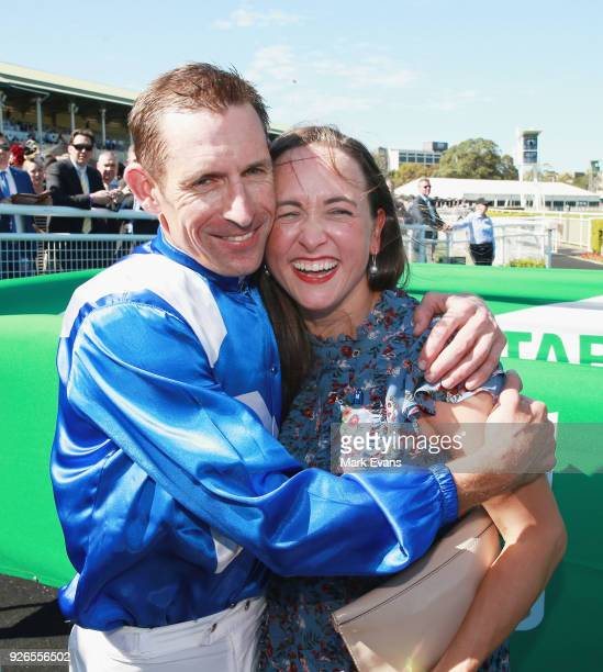 Hugh Bowman hugs wife Christine after winning race 6 riding Winx in The Chipping Norton Stakes during Sydney Racing at Royal Randwick Racecourse on...