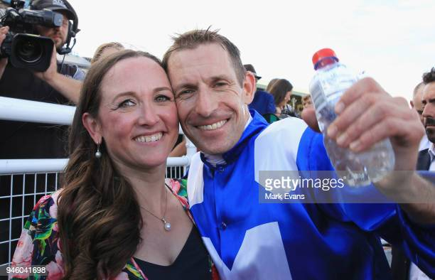 Hugh Bowman hugs wife Christine after winning race 7 The Queen Elizabeth Stakes during day two of The Championships as part of Sydney Racing at Royal...
