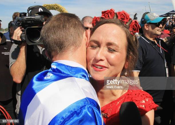 Hugh Bowman hugs wife Christine after winning the George Ryder Stakes on Winxduring Golden Slipper Day at Rosehill Gardens on March 24, 2018 in...
