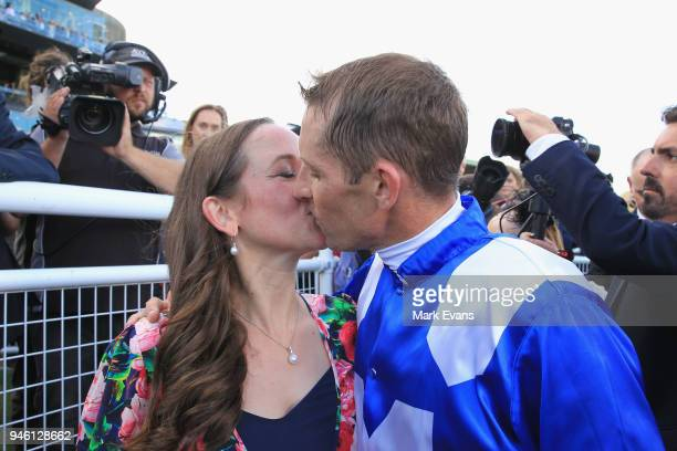 Hugh Bowman kisses wife Christine after winning race 7 The Queen Elizabeth Stakes during day two of The Championships as part of Sydney Racing at...