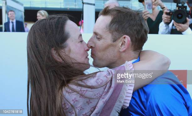 Hugh Bowman kisses wife Christine after winning The Epsom on Hartnell during Sydney Racing at Royal Randwick Racecourse on September 29, 2018 in...