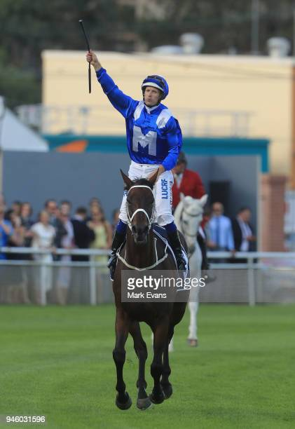 Hugh Bowman on Winx salutes the crowd as he returns to scale after winning race 7 the Queen Elizabeth Stakes during day two of The Championships as...