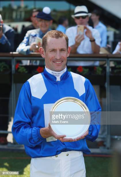 Hugh Bowman poses for photographs after recieving the Best Jockey in the World Trophy after he rode Winx in a barrier trial on Apollo Stakes Day at...