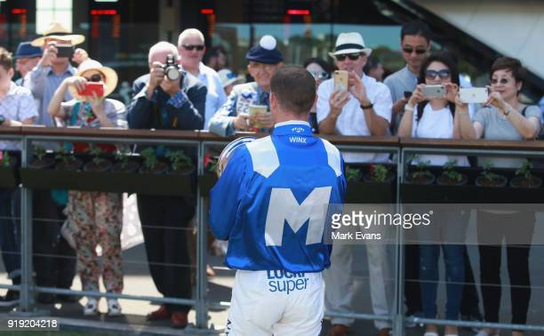 Hugh Bowman poses for photographs from the crowd after recieving the Best Jockey in the World trophy after he rode Winx in a barrier trial on Apollo...