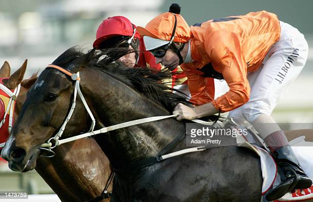 Hugh Bowman rides 'Empire' to victory during Race 7 The King Gee Shorts at Royal Randwick in Sydney Australia October 7 2002
