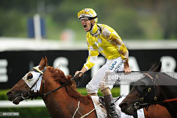 Hugh Bowman riding Criterion celebrates on the finishing line to win Race 6, the BMW Australian Derby during day one of The Championships at Royal...
